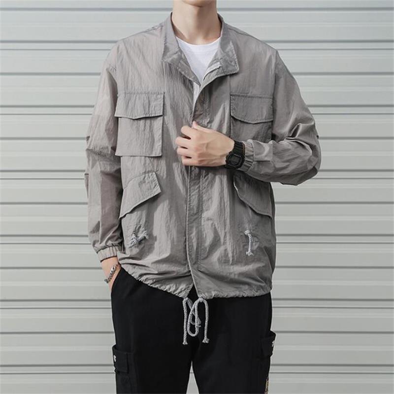 Moda coreana versátil ropa suelta multi-bolsillos cordón hombres chaqueta streetwear hip hop color sólido homme abrigos