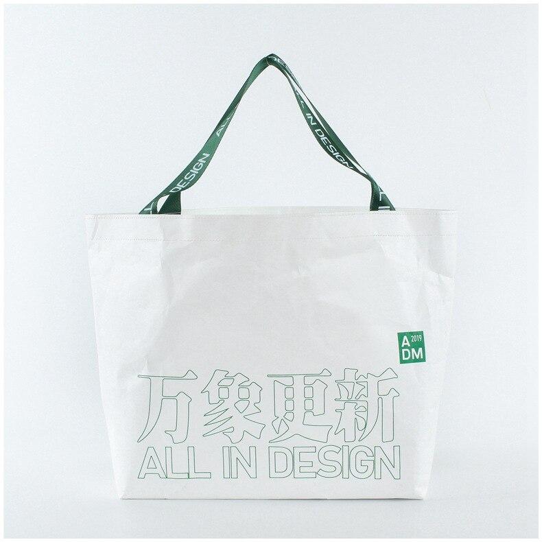 1000 Uds. Al por mayor bolsa de papel kraft lavada bolso de lona retro logotipo japonés personalizado marrón Tyvek bolsa de compras de papel