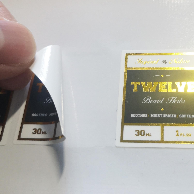 O fundo branco do pvc do pedido feito sob encomenda imprimiu com tinta preta e carimbo quente da folha de ouro, artigo não cu20