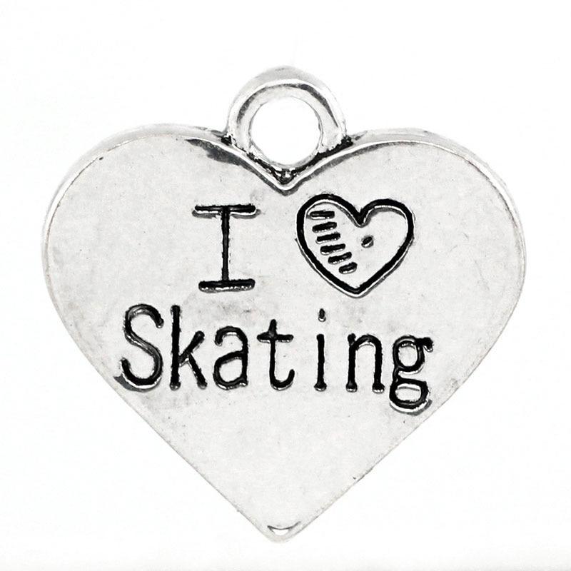 "Colgantes con dije doreenbeads Corazón ""I Love Skating"" Mensaje tallado color plata antigua 17,7x18mm, 20 piezas (B25290)"