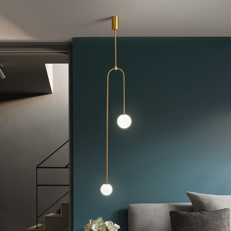 Lámpara colgante para la cama de diseño moderno y creativo de estilo nórdico, lámpara colgante de una sola línea geométrica dorada