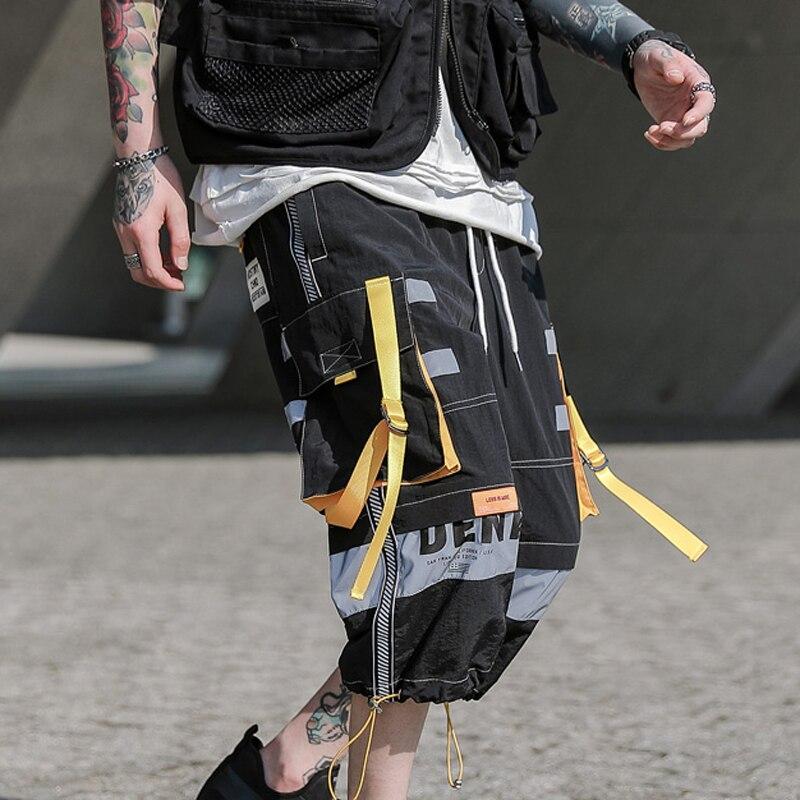 Nova chegada multi bolso hip hop shorts homens fita elástica cintura shorts harajuku streetwear carga dos homens calças curtas masculino