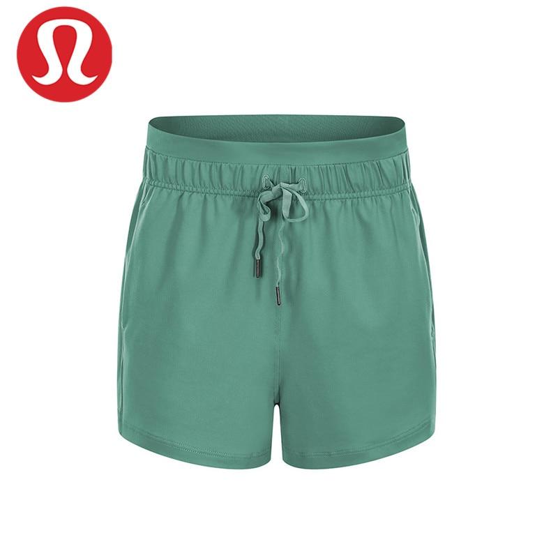 LULU-pantalones cortos deportivos de tres cuartos, de Color sólido, con bolsillos, holgados...