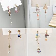 Nuevos pendientes colgantes asimétricos de estilo para mujer, bonitos pendientes colgantes con forma de estrella, Luna y cara, joyería y amuletos de regalo