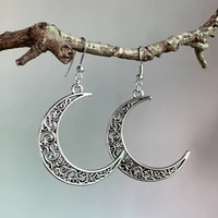 retro hollow out the moon eardrop that connect a flower to europe and the united states earrings