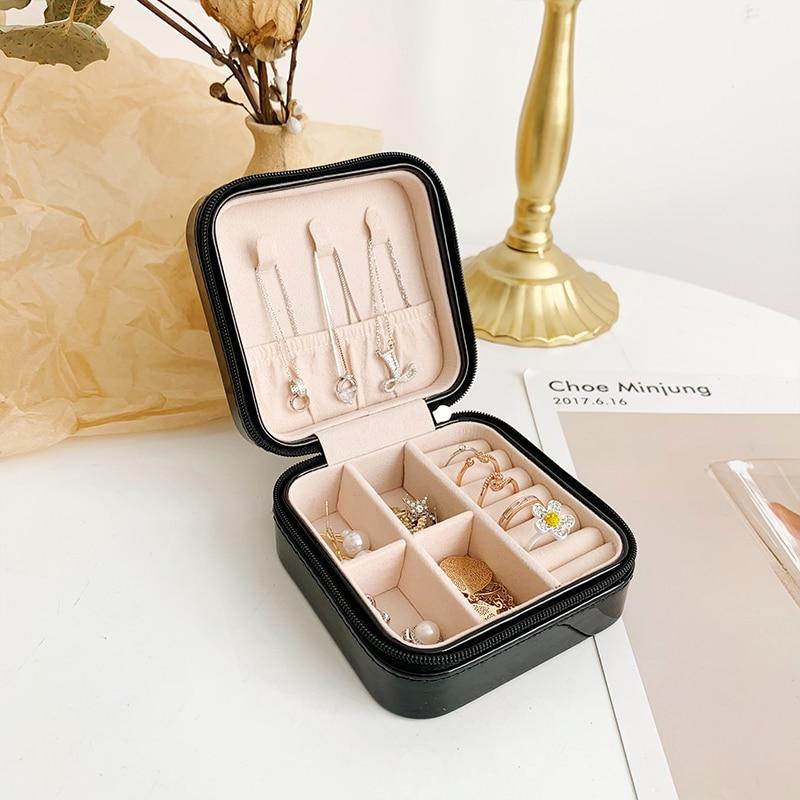 Caja de almacenamiento de joyería de moda de fibra de PU, organizador de pendientes, collar de anillo, joyería, cremallera portátil, caja de belleza de lápiz labial de chica