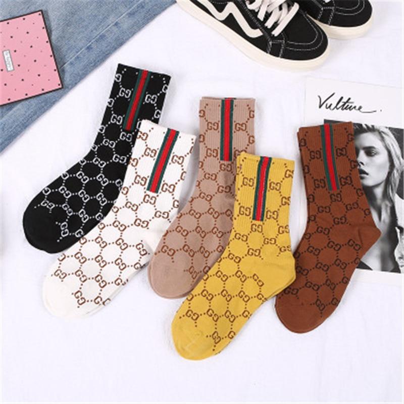 New European station socks women's stockings bright silk letters net red fashion Japanese wild trend stockings
