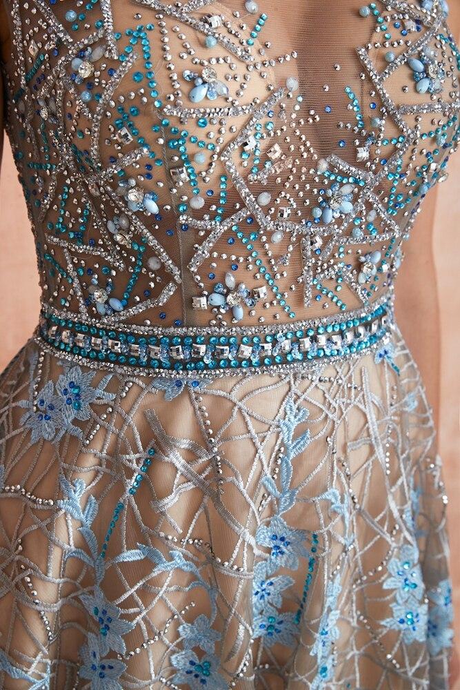 Купить с кэшбэком Blue Lace Prom Dresses 2020 Beaded Rhinestone A Line Cap Sleeves Long Sheer Neck Evening Gowns Engagement Dress Abendkleider