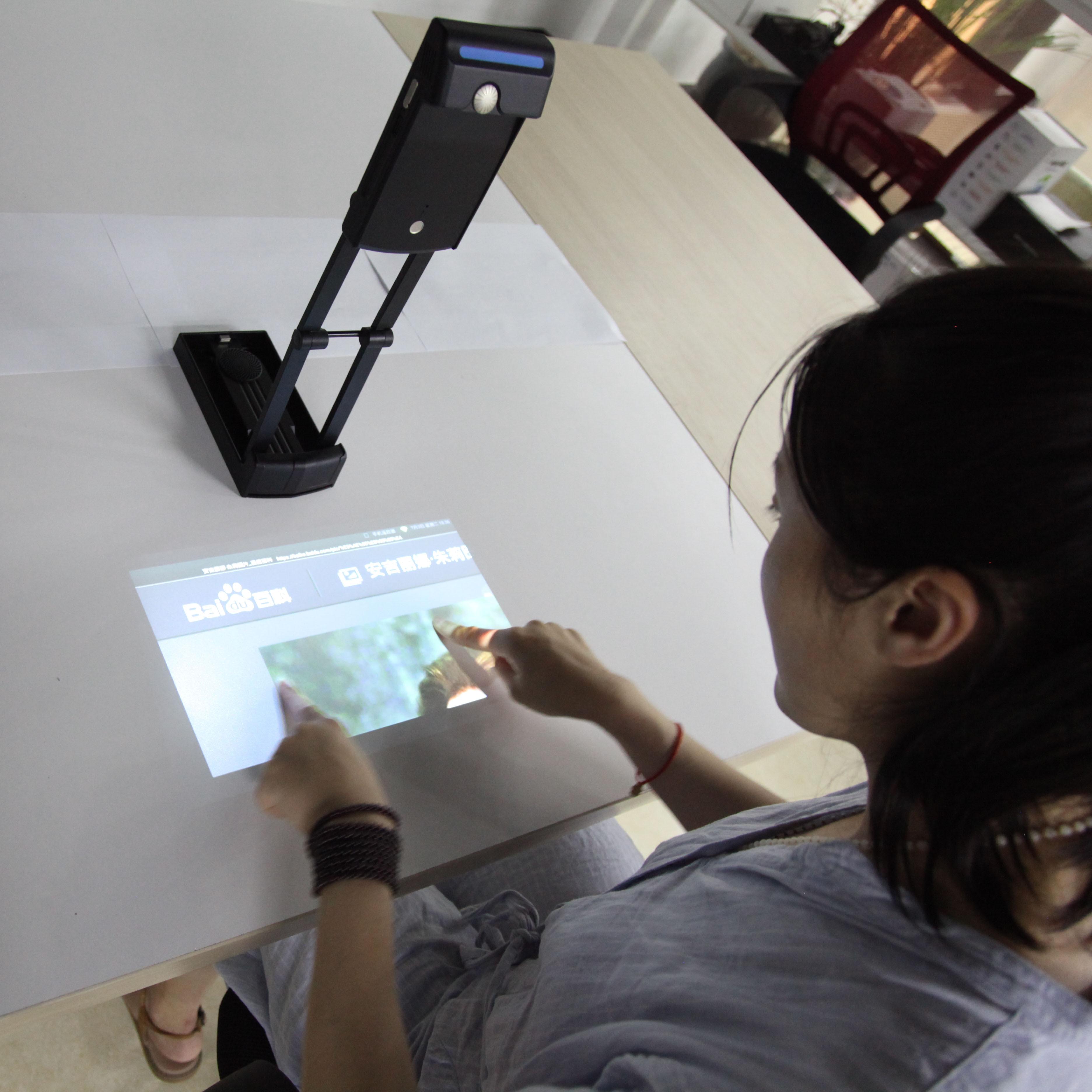 جهاز عرض متعدد الوسائط واي فاي تفاعلي محمول, تقنية معايرة الصور بالليزر