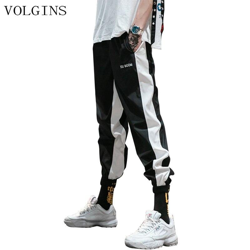 Streetwear 2020 Sweatpants hombres mujeres Casual negro blanco rayas moda hombres pantalones Hip Hop pantalones Harem pantalones para hombre