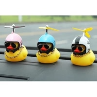 a cute little yellow duck with a propeller a rubber duck in a windbreaker with a helmet car decoration childrens toy