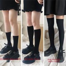 Calzini donna JK simpatici calzini lunghi Lolita in velluto bianco nero calzini alti al ginocchio tinta unita moda Kawaii Cosplay calze di Nylon Sexy
