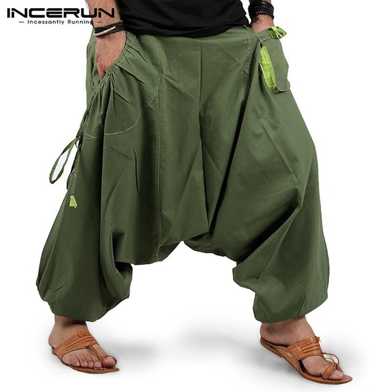 Брюки мужские с заниженной мотней, модные джоггеры, брюки свободного покроя с эластичным поясом, однотонные штаны с карманами, уличная одеж...