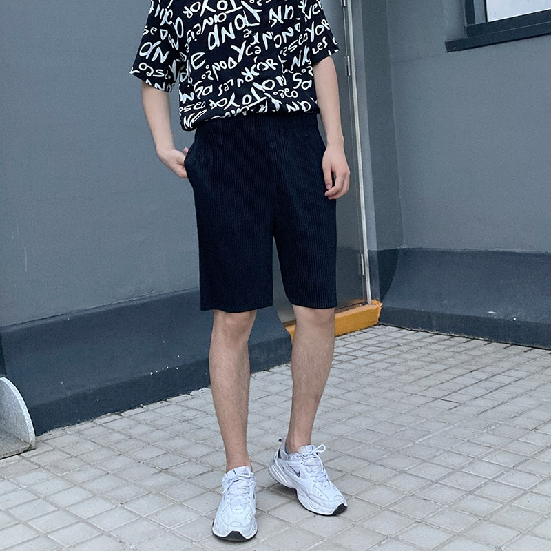 Plus Size Unisex Shorts Summer 2021 New High Waist Solid Color Elastic Loose Miyake Pleated Straight Shorts For Men And Women