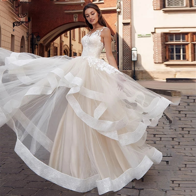 Get Luxury A-Line Wedding Dresses Sleeveless Backless Lace Applique Charming Gowns Delicate Layered Glitter Ruffle vestidos de novia