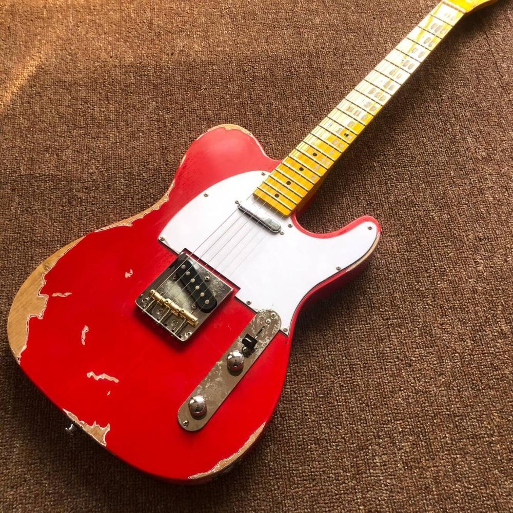 Guitarra eléctrica de 6 cuerdas de alta calidad, palillos de arce gitaar a mano. guitarra de color rojo