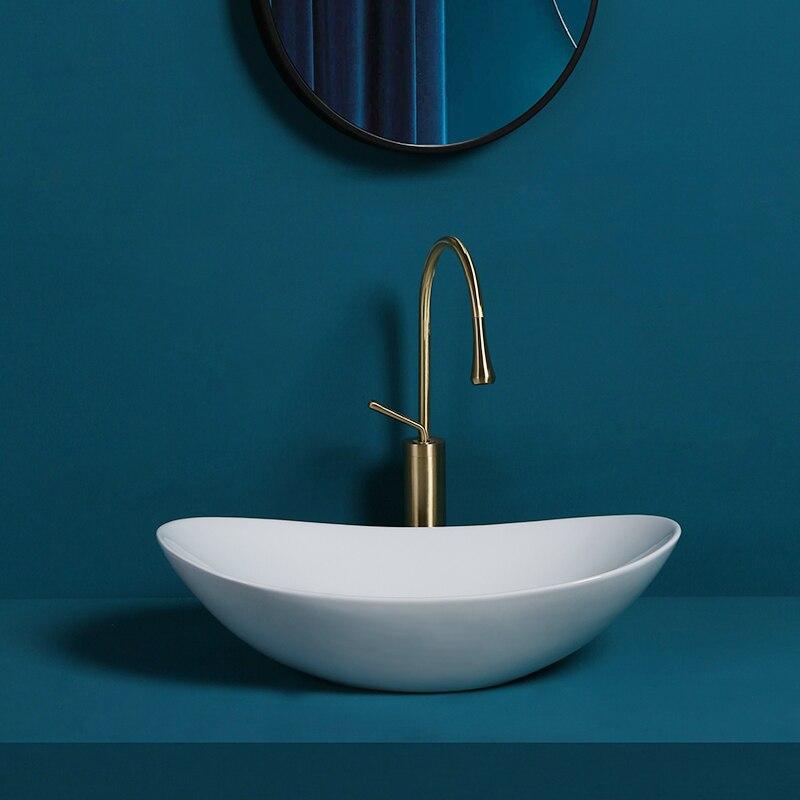 Nórdicos encimera de fregaderos art lavabo cuarto de baño lavabos de cerámica blanco recipiente de lavabo sumideros de lavado de manos cuenca oval inodoro lavabo