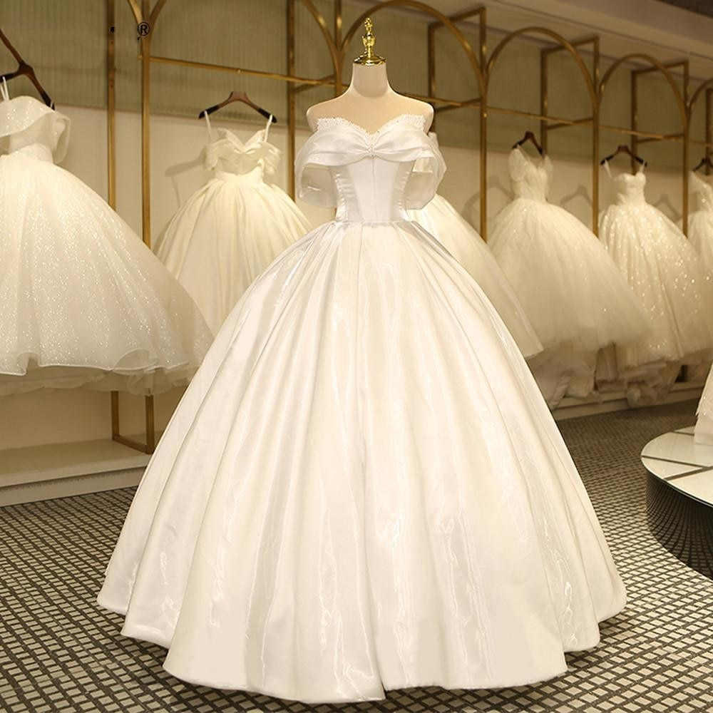 Review Elegant Arabic Dubai Plus Size Ball Gown Wedding Gowns Sweep Train Pearls Beaded Vestido De Novia Bridal Dresses Custom Made