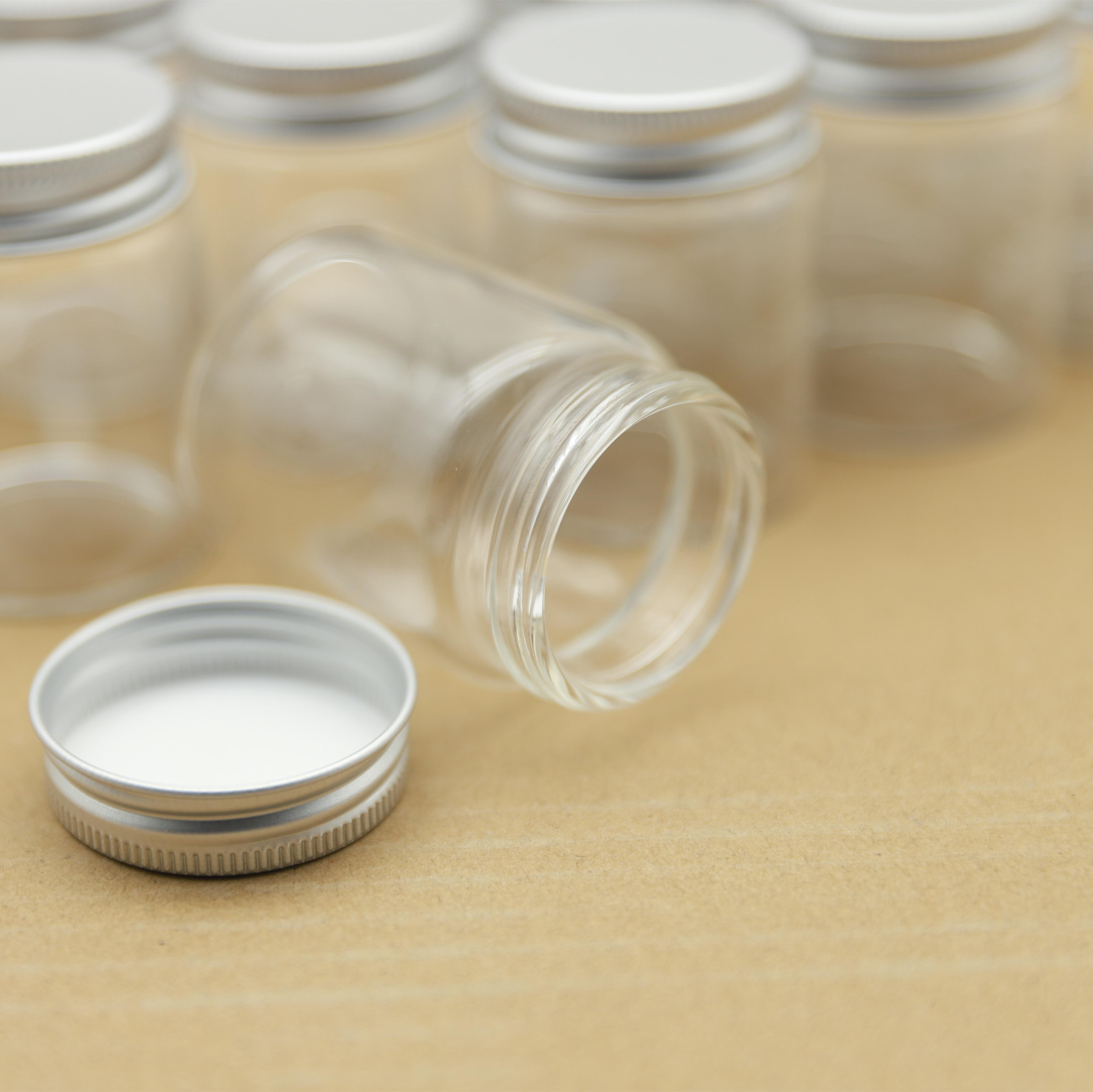 برطمانات زجاجية صغيرة شفافة ، برطمانات زجاجية صغيرة مع غطاء لولبي فضي ، برطمانات تخزين صغيرة ، زجاجات فارغة ، 47 × 60 مللي متر ، 60 مللي ، 12 قطعة