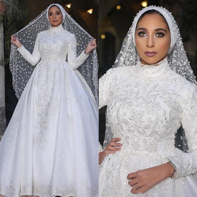 فساتين زفاف إسلامية عربية متواضعة 2021 رقبة عالية كم طويل مزينة بالدانتيل تنورة انفصال تنورة إسلامية طويلة زي العرائس
