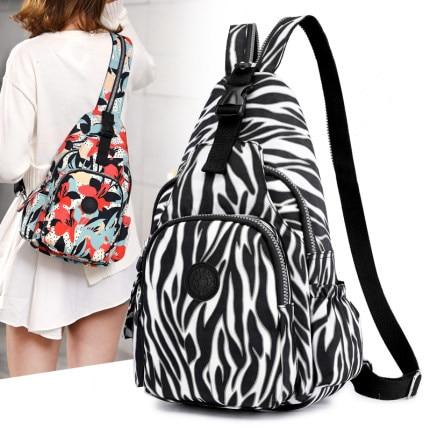 ¡Novedad de 2020! Bolso de hombro de tela lavada con patrón de cebra, bolso de tela de gran capacidad, mochila de viaje impermeable para mujer