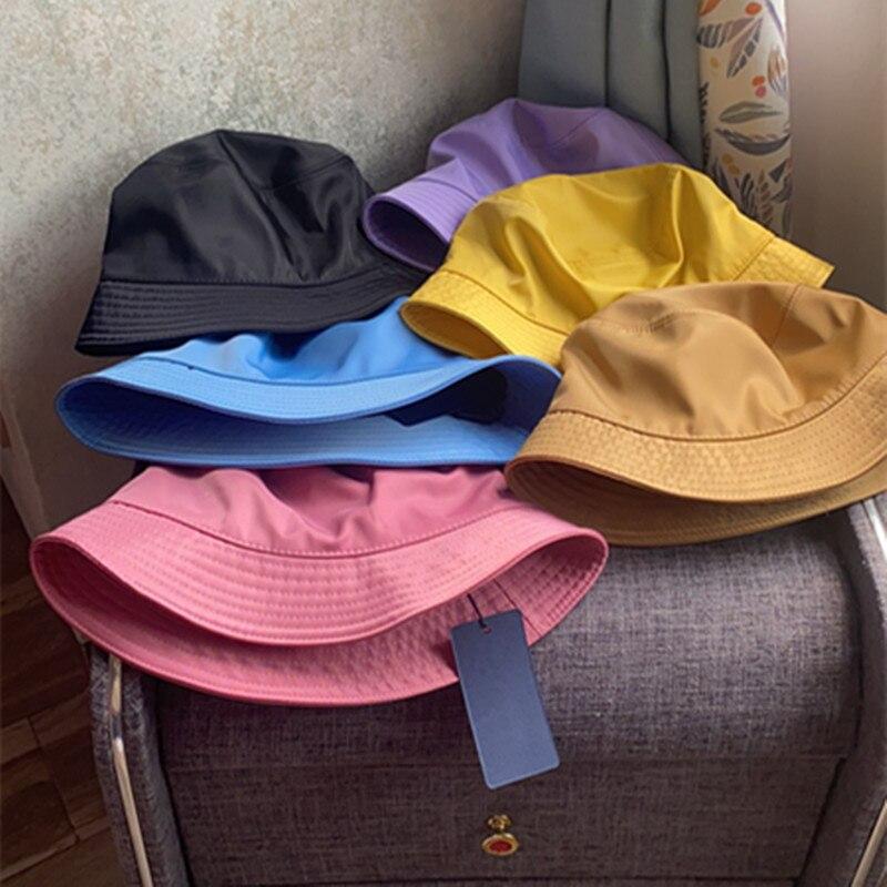 لحظة 2021 نمط جديد فاخر دلو القبعات النساء موضة العلامة التجارية مصمم حوض قبعة قبعة واقية من الشمس الأسود في الهواء الطلق السفر قبعة الرجال