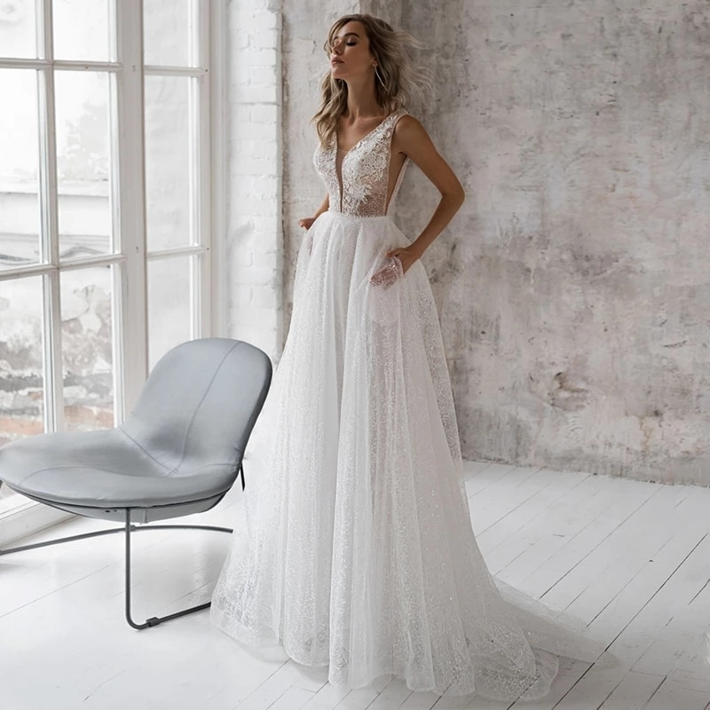 Review Elegant Lace Wedding Dresses For Bride 2021 Lace Appliques Beach Bridal Gown For Women Backless Sexy Wedding Gowns With Pockets