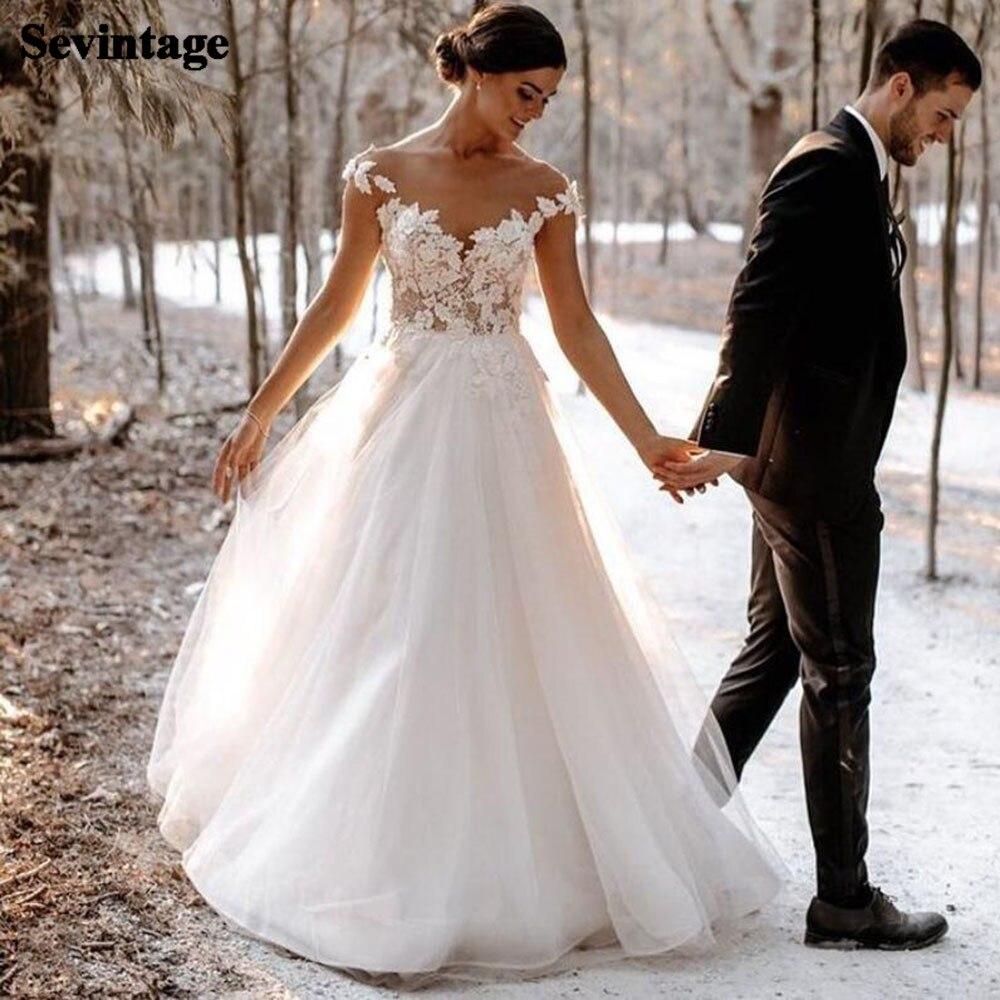 Sevintage Beach Lace Wedding Gowns 2021 Sheer O-neck Appliques Cap Sleeves Wedding Dress Boho A Line Princess Long Bride Dresses
