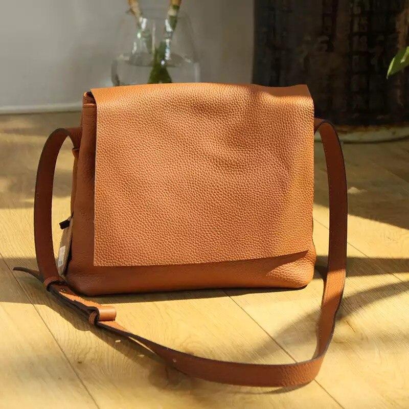 حقيبة كتف صغيرة من الجلد الناعم بتصميم عتيق حقيبة يد صغيرة مُزينة بحقيبة صغيرة مُزينة بأشكال متقاطعة للرجال والنساء