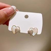 xiyanike sweet hug double heart earrings for women simple small fashion earrings 2020 stud earrings korea statement jewelry