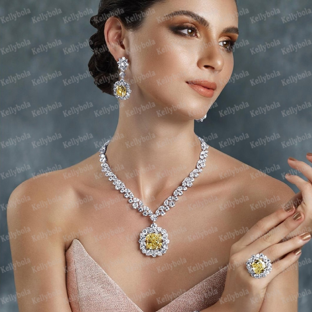 Kellyبولا مجوهرات فاخرة هندسية دلاية من حجر الزركون قلادة سوار القرط القرط 4 قطعة أداء الزفاف الإناث جودة عالية