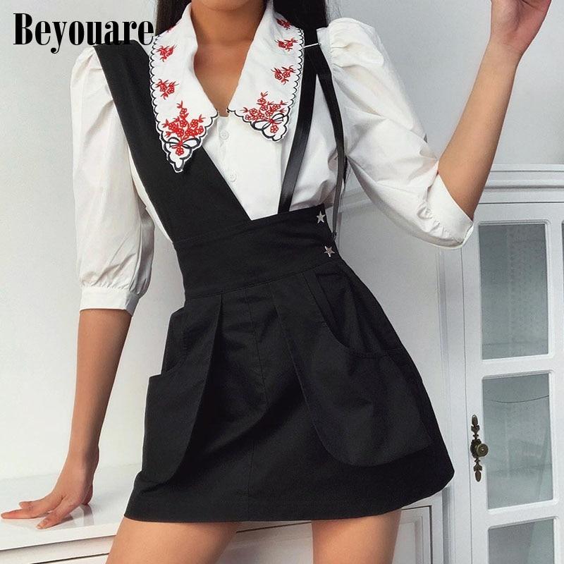 Beyouare negro Casual asimétrica correas Cargo faldas mujeres verano Bottoms gótico Preppy ropa de calle con bolsillos Mini faldas de moda