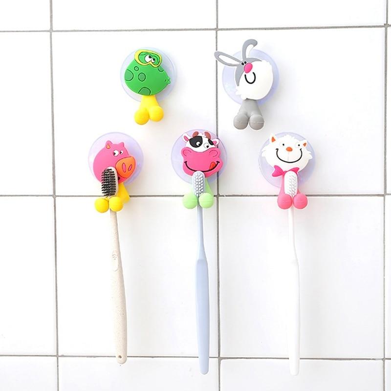 Cuidado del bebé lindo dibujo Animal forma titular Sucker ganchos de succión conjunto colgando bebé cepillo de dientes titular toallas