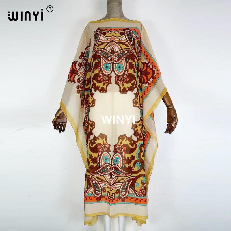 WINYI 2021 فستان حريمي مطبوع 2021 تصميم عصري فستان فضفاض جناح خفاش تنورة طويلة فستان صيفي أنيق لحفلات المرور على الشاطئ