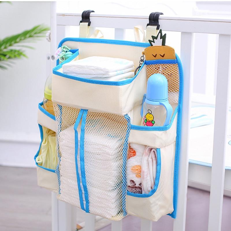 Bolsa de almacenamiento colgante para cama de bebé, bolsillo para pañales, mesita de noche portátil, organizador de ropa de cama para niños, borde azul