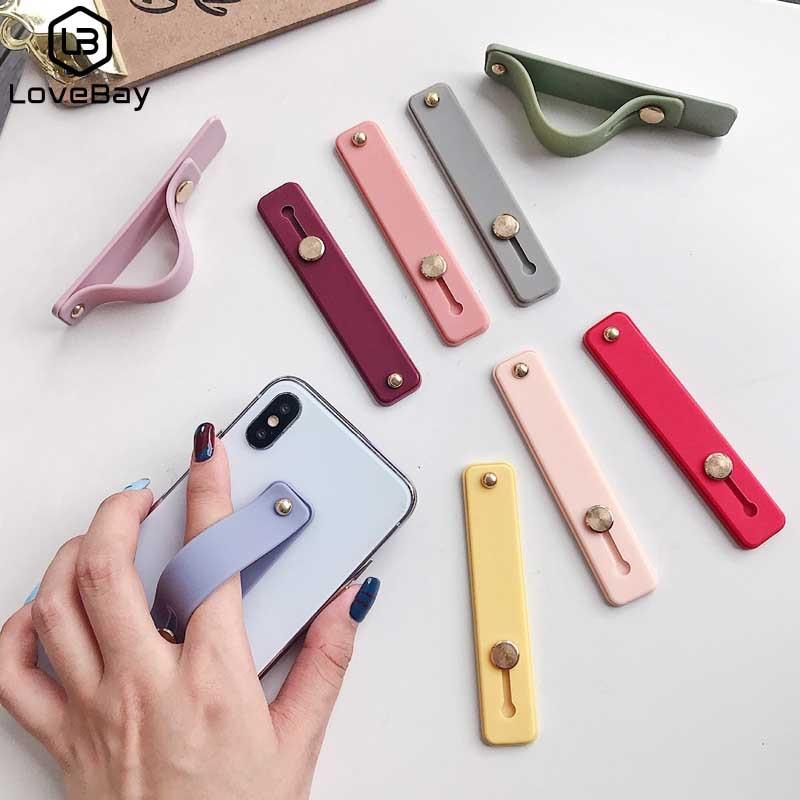 Lovebay Candy Color muñequera banda de mano agarre de dedo soporte para teléfono móvil soporte conector de teléfono Universal para iPhone Xiaomi