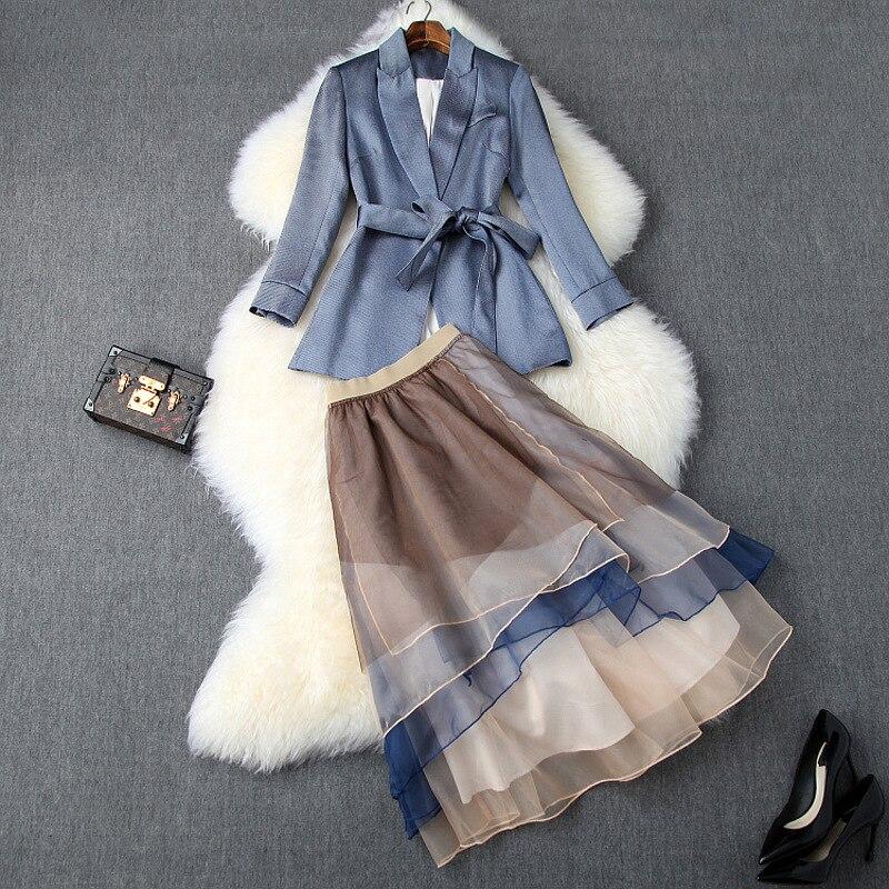 جديد 2019 الخريف النساء الزنانير البلزر الدعاوى منتصف العجل كتلة اللون الأورجانزا الكشكشة تنورة مكتب OL أنيقة قطعتين مجموعة الأزرق