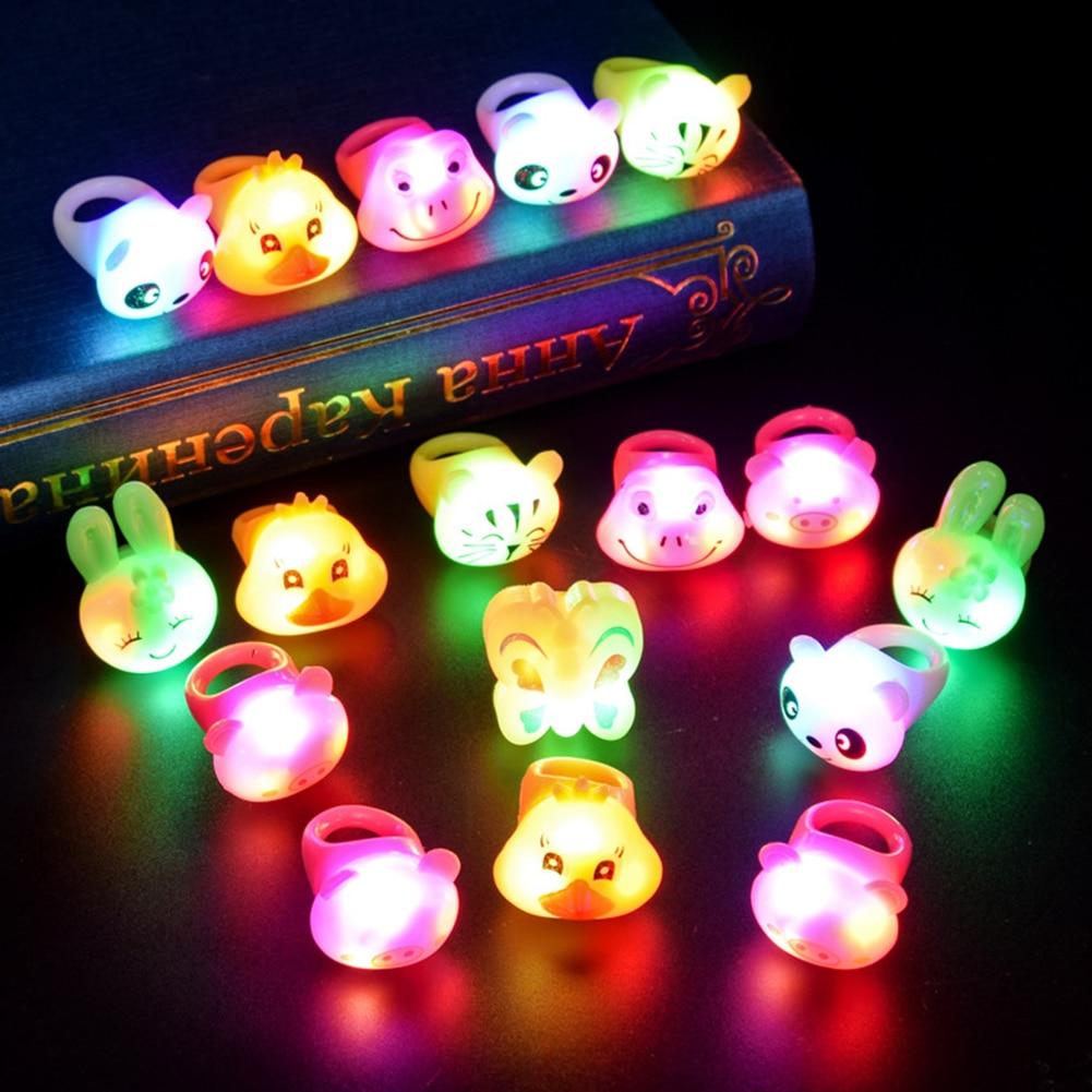 Dibujos Animados LED parpadeante iluminando los juguetes brillantes del anillo del dedo Navidad Año Nuevo Fiesta Favor regalos juguetes para niños