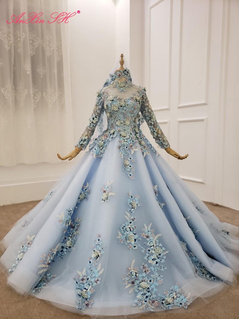 AnXin SH الفاخرة الأميرة الوردي زهرة الأزرق الدانتيل الخرز كريستال عالية الرقبة الوهم كم طويل فستان الزفاف 100% صور حقيقية