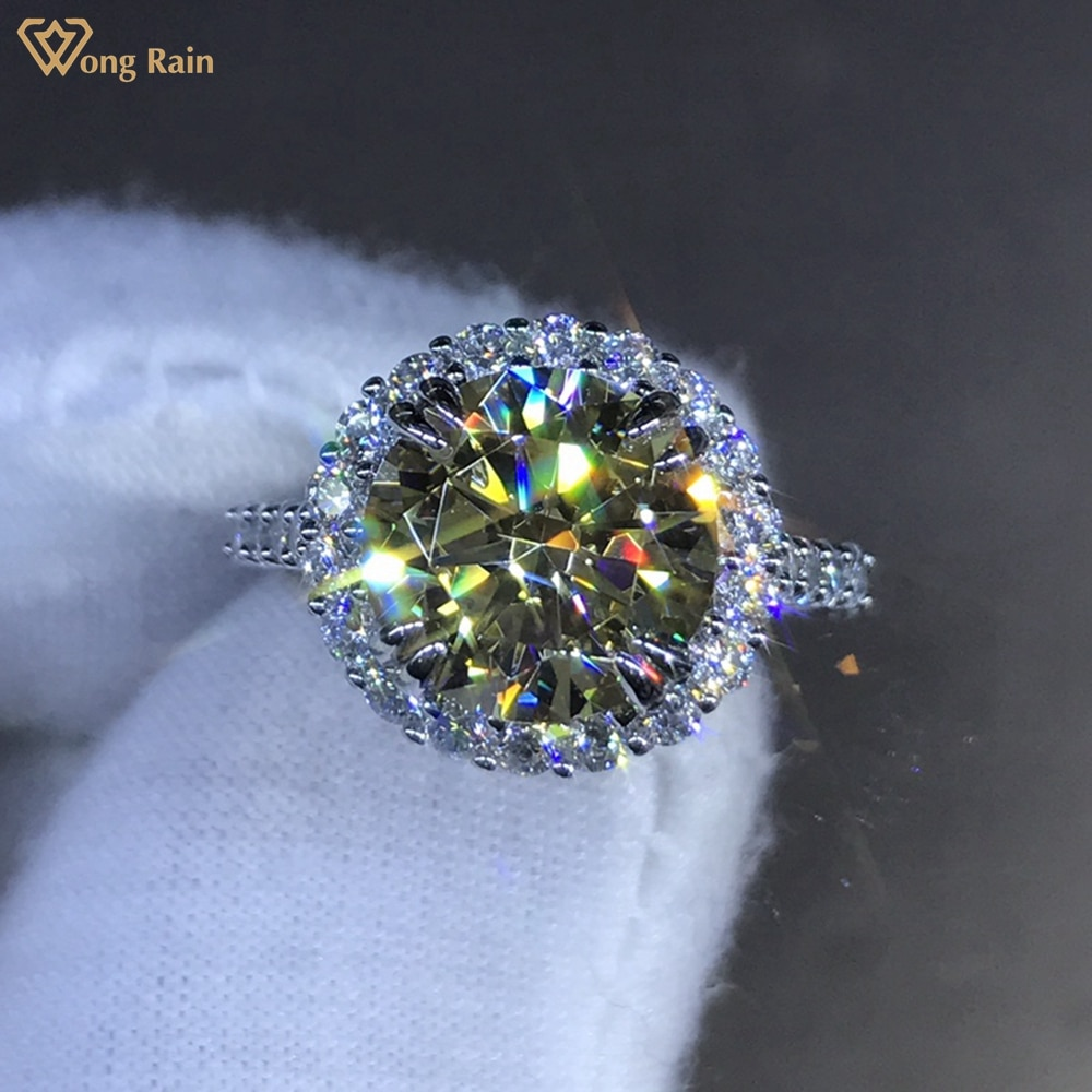 Get Wong Rain 925 Sterling Silver Round Cut 4 CT D Created Moissanite Gemstone Engagement Customized Ring Fine Jewelry Wholesale