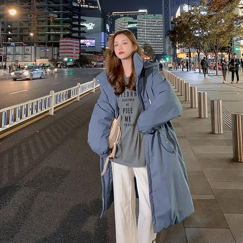 سترة الشتاء الطويلة المتضخم للنساء سترة السيدات نمط الكورية الصلبة مع جيوب التصحيح تصميم فضفاضة معطف الإناث مقنعين