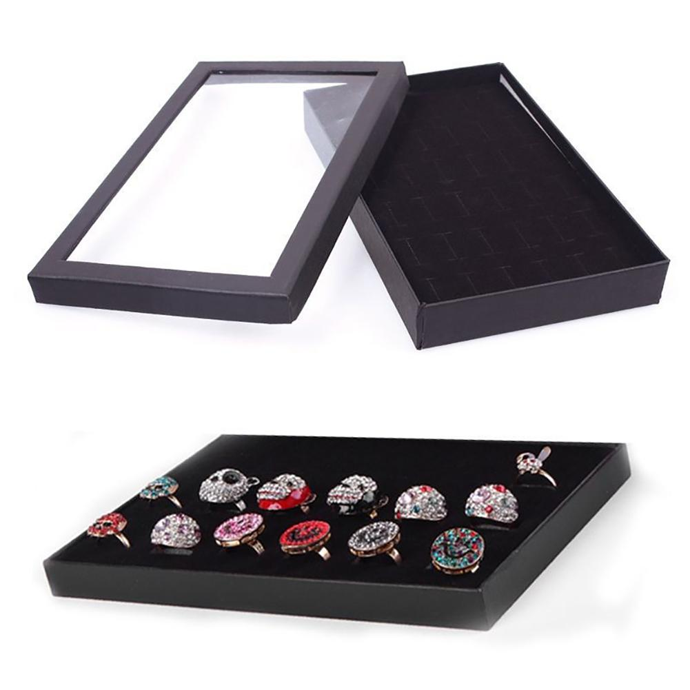 Nueva caja organizadora de joyería de metal transparente con 36 ranuras para exhibir pendientes