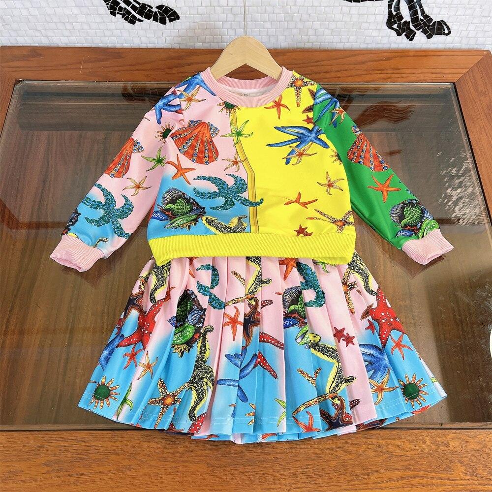 ملابس الأطفال المتفجرة 2021 أوائل الخريف الفتيات المتفجرة الجديدة البحرية الرقبة المستديرة سترة مع تنورة مطوي ، النمط الغربي