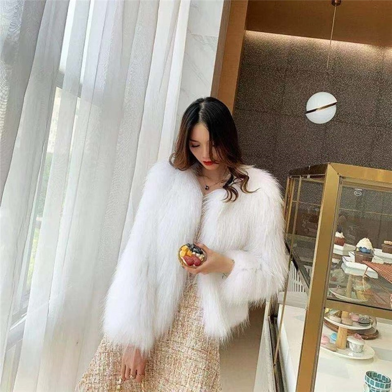 2021 spring and autumn new fur coat female young short short hairy raccoon fur slim round neck thin female