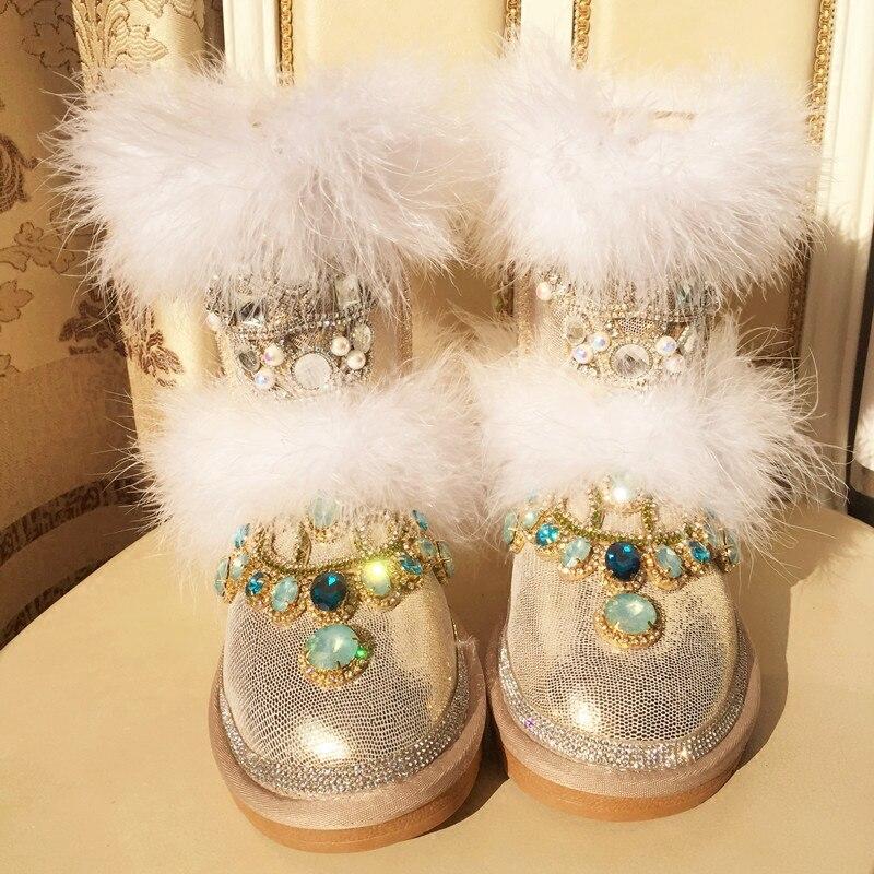 Invierno 2020 gama alta Diamante de imitación personalizado pelo de avestruz luz oro medio tubo grueso terciopelo de cuero cálida botas de nieve botas de algodón