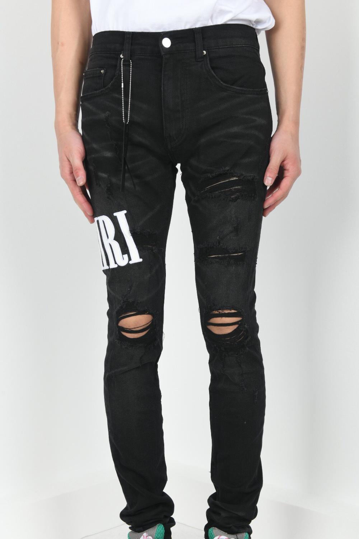 Los hombres bordado elástico skinny jeans apenado y negro-indigo