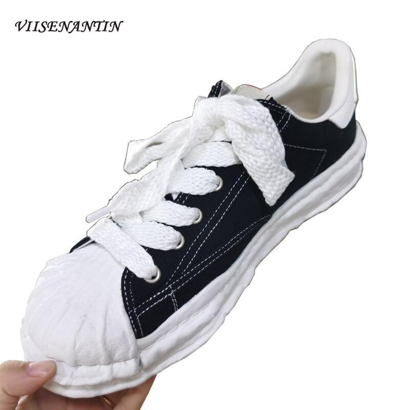 أحذية رياضية كاجوال تذويب قماش سميكة سوليد زوجين عالية الكعب أحذية النساء والرجال الأسود الدانتيل يصل شقة Platfrom حذاء واحد 2021