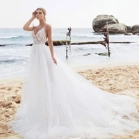 2021 charming beach wedding dresses spaghetti straps a line lace appliques backless tulle bridal gown sweep train