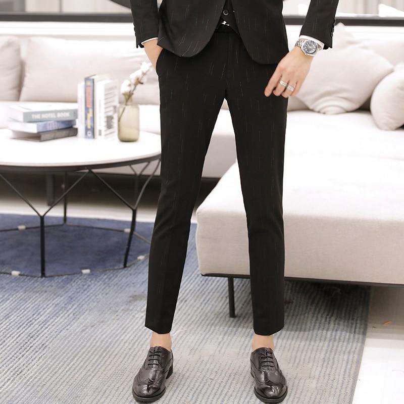 صيف جديد الكورية نمط سليم المناسب أقدام صغيرة سراويل تقليدية رجال الأعمال العصرية غير الحديد تسعة بنطلون