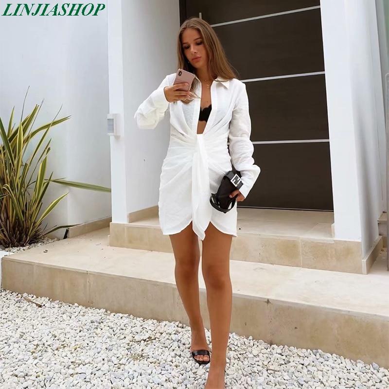 تصميم خاص تصميم فستان قصير الصيف طويلة الأكمام النساء عدم انتظام مطوي مهنة نمط مثير فضفاض الأبيض shirtdress